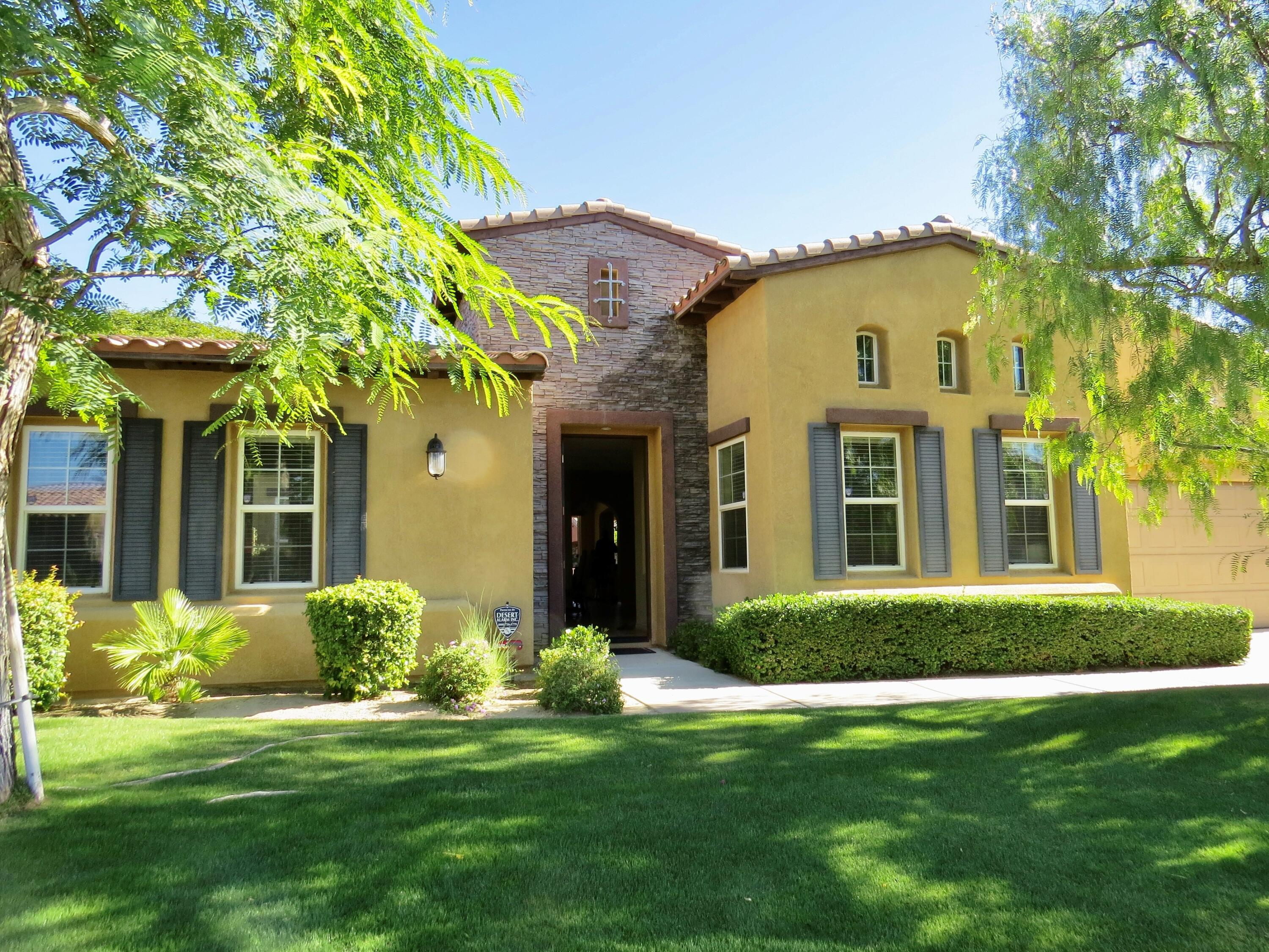 Obvious Pride of Ownership is presented in this lovely Tuscan style home in the highly desirable gated, lake community of Santo Tomas. Situated in a quiet interior cul-de-sac with northwesterly views, this 2307 sf home offers vaulted ceilings, and tile floors throughout. Three en-suite bedrooms with a large Master Suite, and 2 guest bedrooms, one with it's own private courtyard entry. A gourmet kitchen with island, and stainless steel appliances installed last year, opens to the great room with fireplace and backyard views. Rear and side patios re-envisioned with elegant pavers that border the oversized 40 foot swimming pool! Add a raised spa with waterfall, fire pit and cool, covered patio spaces, one has a perfectly designed backyard for all to gather or for one to simply swim laps and relax. Centrally located in the Valley, Santo Tomas offers a small community of 152 homes, a 9 acre recreational lake, 5 parks and waterfalls. Low HOA's which INCLUDE membership to the fitness and social amenities of Mission Hills Country Club (just across the street). This is an added bonus to a truly special home! Furnishings and artwork available under a separate contract.
