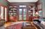 Library with access to deck and door to Living Room