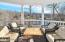 Covered Outdoor Seating Area with lake views off Living Room