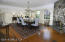 Room for all in generously sized dining room w orig wainscoting. High ceilings.