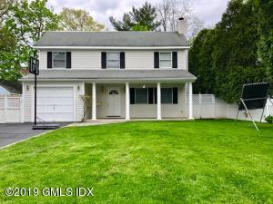 Enjoy a Front Porch and Fenced in Yard in Old Greenwich