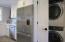 Bosch dishwasher, Fisher & Paykel fridge, adjacent washer/dryer alcove
