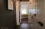 Hallway with wall of custom closets
