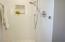Custom shower with marble floor, Kohler fixtures