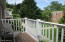 Balcony overlooks courtyard with expansive lawns and gardens
