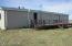 Large back deck with mitigation system showing for radon