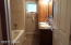 MAIN FLOOR BATH WITH JETTED TUB, TILE, DOUBLE SINKS