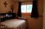 LOWER LEVEL BEDROOM IN DAYLIGHT BASEMENT