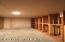 Wine cellar is located in downstairs family room.