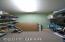 Basement bedroom closet, an organizers dream.