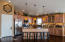 Kitchen with hickory cabinets, granite counter tops, large pantry and great breakfast bar