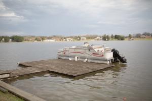 Private Dock & Triton Pontoon Boat