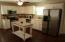 Open kitchen/breakfast area. Concrete floors - no carpet.
