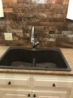 SINK WITH STONE BACKSPLASH