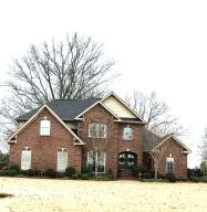 BEAUTIFUL HOME IN MINT CONDITION FEATURING 4BR/3.5 BA WITH A 24X24 WIRED SHOP. MATURE LANDSCAPING WITH SPRINKLER SYSTEM.