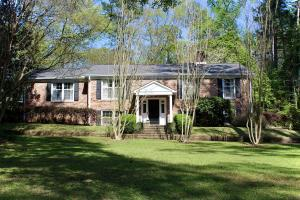 Wonderful family home located in prestigious Country Club Subdivision. Circle drive with mature landscaping. Antique bricks and oversized front lawn.