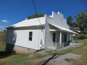 1 Bedroom 1 Bath home fronts 219, will contain 3 lots when seperated.