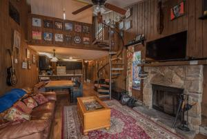 Living area with a wood burning fireplace.