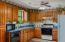 full kitchen, oak cabinets