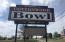 This sign is vintage! over 50 years old and is located right next to the highway.