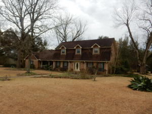 3000+ sq ft. living area. Eleven acres. Three outbuildings
