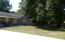 Two lots. 3 bedrooms, 2 baths. Hardwood floors. Outdoor living area.