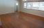 Hardwood floors. Lots of light. View toward foyer.Sheetrock.