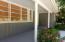 Concrete porch. Landscaping.