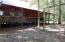 Wood floors, walls, ceilings. Wrap around porch. Metal roof
