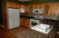 Granite. Appliances remain. Has breakfast area with view of back area.