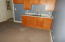 Living/kitchenette area. Place for refrigerator. Carpet. Opens to sunroom.