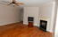 Beautiful floors. Nine foot ceilings. Natural gas logs. Kitchen is to the right.