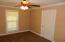 Walk in closet. Carpet. Sheetrock. Fan
