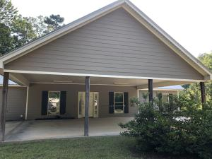 PORTE COCHERE ON FRONT ALSO ALLOWS FOR ENTERTAINING AS A BIG COVERED PORCH.