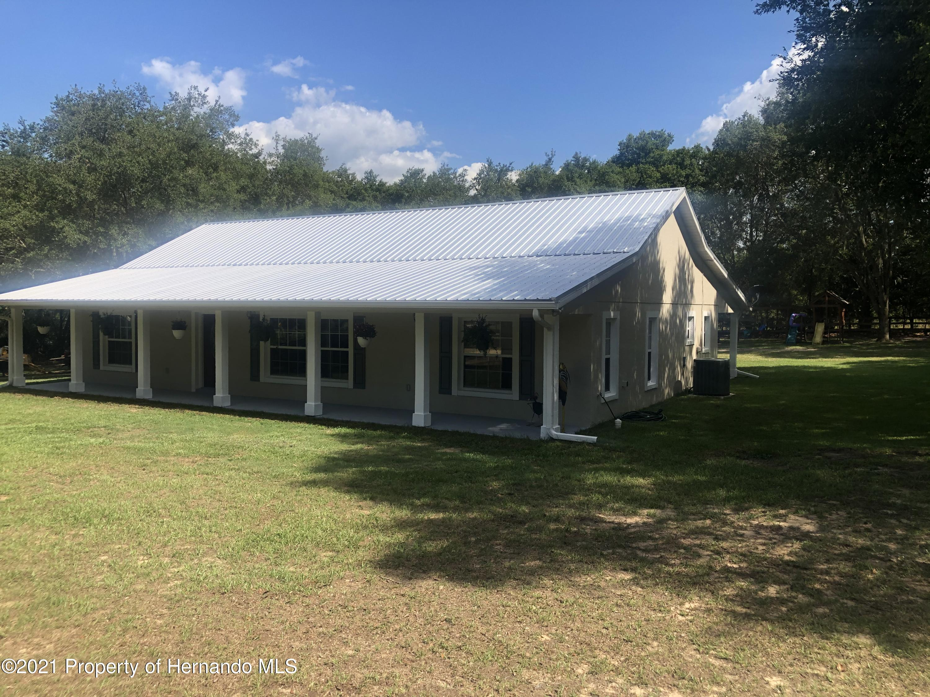 Listing photo id 3 for 7910 E Derby Oaks Drive