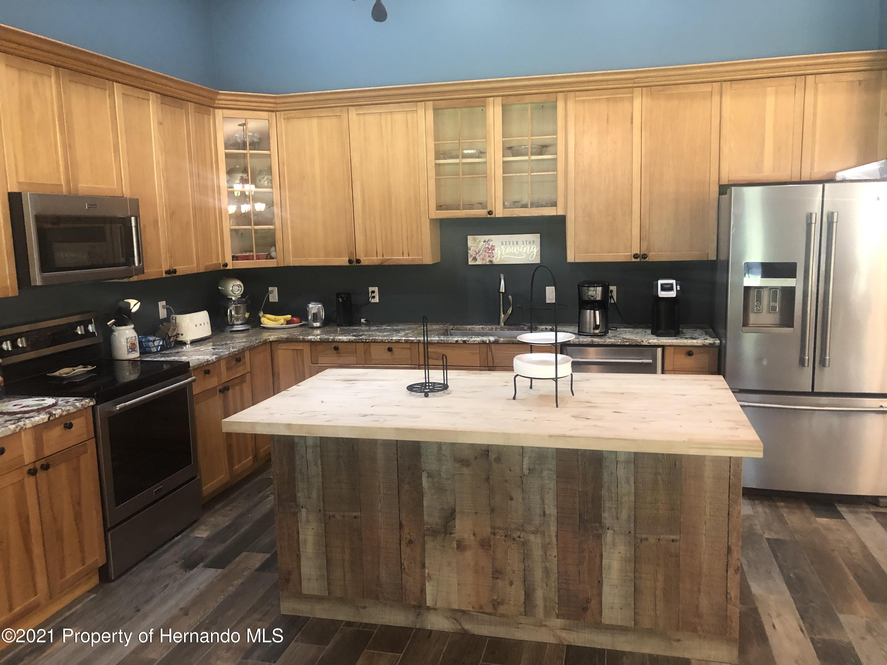 Listing photo id 4 for 7910 E Derby Oaks Drive