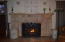 Beautiful gas fireplace insert with original hearth and mantle