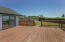 South West facing upstairs deck. Great for all day sunshine, great view of the pastures and ocean and entertaining.