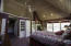 Master suite with built-ins and wood burning fireplace and vaulted ceiling