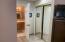 Closet/dressing room area to bathroom