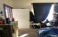 Living room, looking toward entryway.
