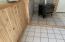 Wood stove, tile and wainscoting