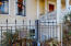The Magdalena Zanone Home Historical Register Plaque & Iron Fence Detail
