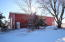 40x70 Metal Building, 16 ft sidewalls, 2 14x16 garage doors, concrete area w/in floor heat.