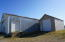 20' x 43' wood framed storage built in 1942 and moved to site in 1987. Concrete floor, newer siding and roof. Electricity.