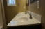 Double sinks with granite countertop