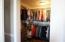 Access door to crawl space on closet floor.
