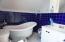 Luxurious Soaker Tub, Handheld shower, ceramic wall tile, oak & porcelain tile floor, laminate vanity, cabinets & large linen cabinet