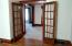 French doors from dining room to entryway/sitting room.