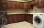 With Custom Cabinetry & Tiled Floors